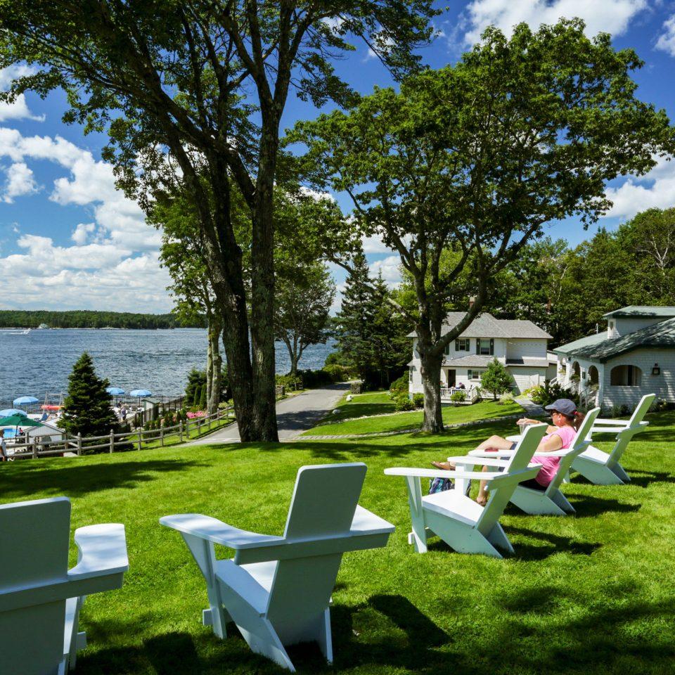 Inn Lounge Ocean Resort Waterfront grass tree sky Picnic leisure lawn green park backyard chair overlooking Garden lush