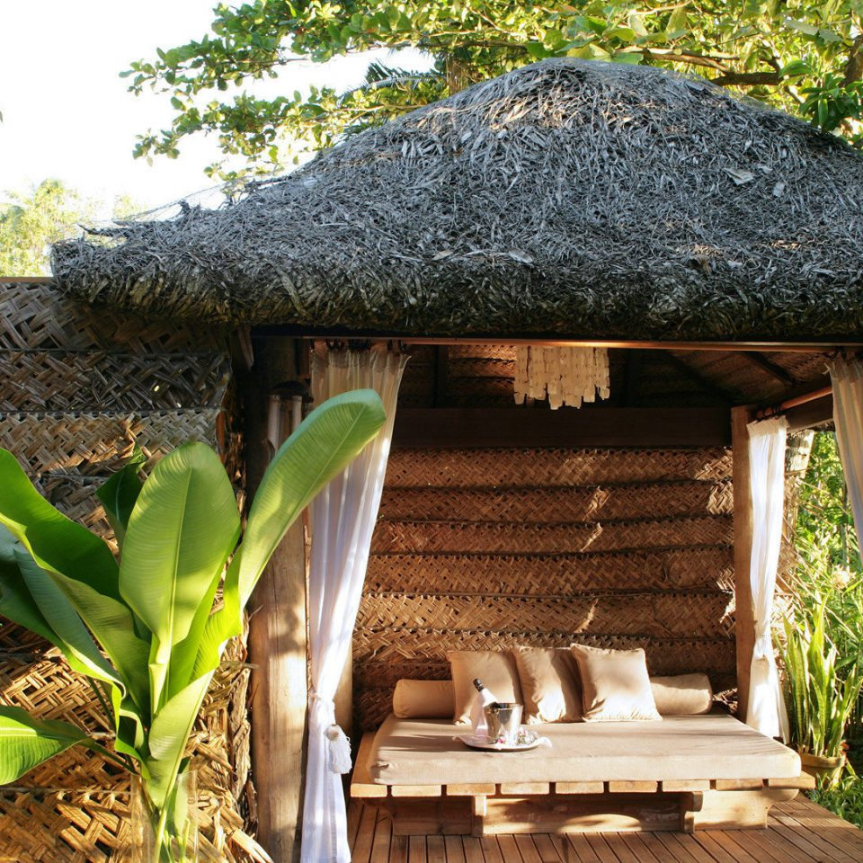 tree building chair backyard Garden outdoor structure cottage Jungle hut shade yard roof