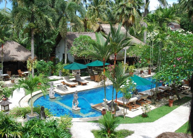 tree Resort property swimming pool ecosystem arecales lawn Garden plant Villa palm backyard Pool Water park eco hotel caribbean Jungle condominium colorful lined