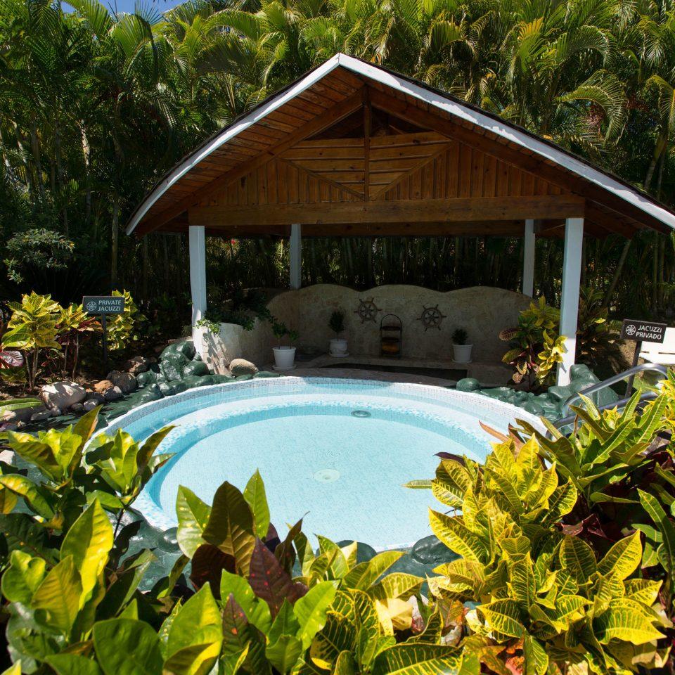 tree Resort house Garden backyard Jungle cottage yard swimming pool flower outdoor structure pond botanical garden rainforest vegetable