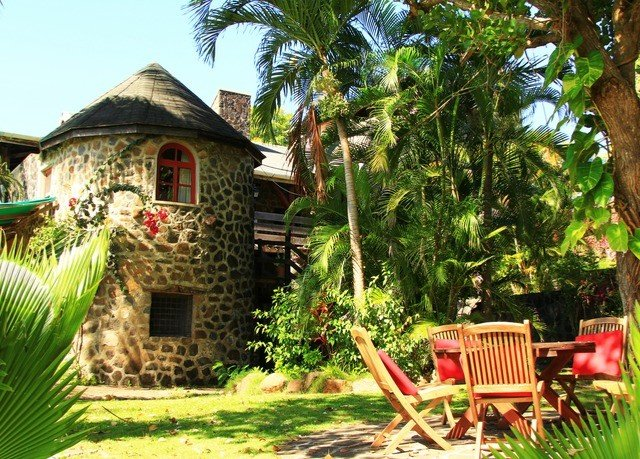 tree property Resort house home cottage Jungle Villa eco hotel backyard Village hacienda Garden plant stone surrounded shade