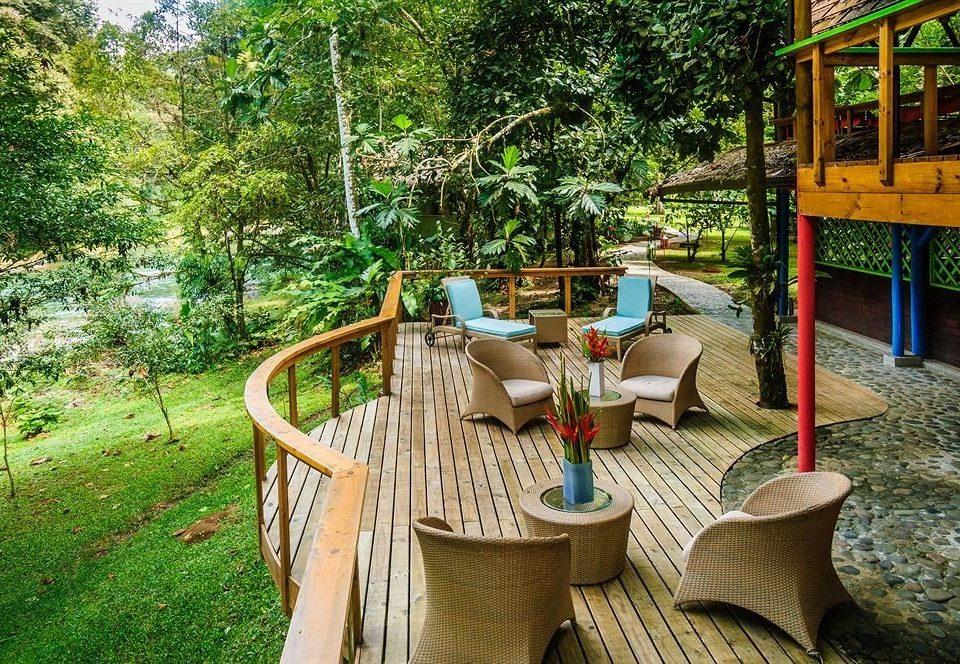 tree grass chair leisure Resort backyard cottage outdoor structure Garden Jungle porch Villa yard stone