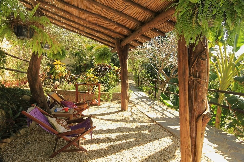 ground tree property Resort building backyard Jungle cottage Villa outdoor structure eco hotel Garden yard porch shade