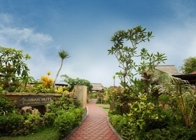 tree property Resort flora plant botany Garden arecales condominium home Villa flower botanical garden mansion hacienda Jungle plantation palm family bushes stone