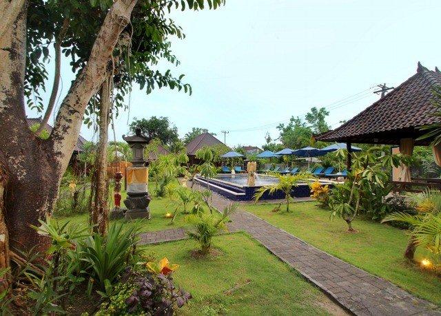 tree grass sky property Resort Village Jungle cottage plant Garden