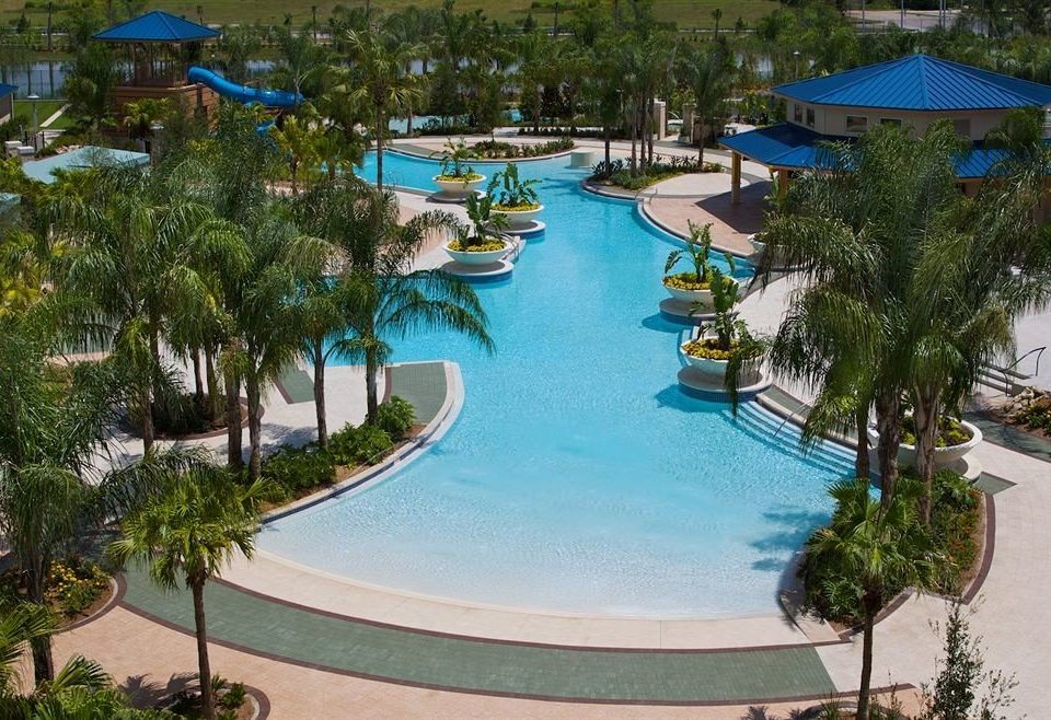 tree Resort umbrella Pool swimming pool leisure property Water park amusement park park resort town Villa condominium lawn Lagoon palm lined swimming Garden