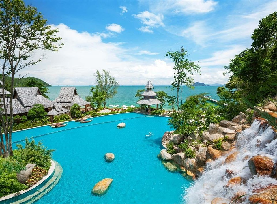 tree sky swimming pool leisure Resort caribbean resort town Water park Lagoon amusement park Garden plant surrounded