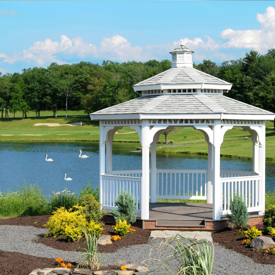 tree grass sky building gazebo Lake flower outdoor structure park pavilion Garden pond surrounded stone