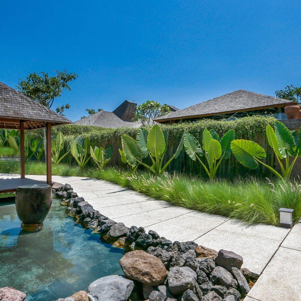 Lounge Pool Tropical sky rock property Resort swimming pool Villa Village Sea backyard stone Garden