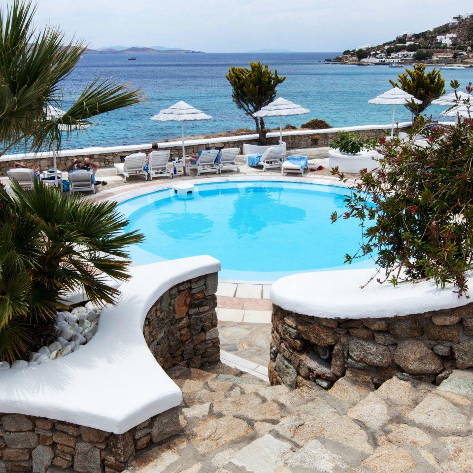 tree sky swimming pool property Resort Villa home Nature condominium backyard Sea mansion stone Garden shore