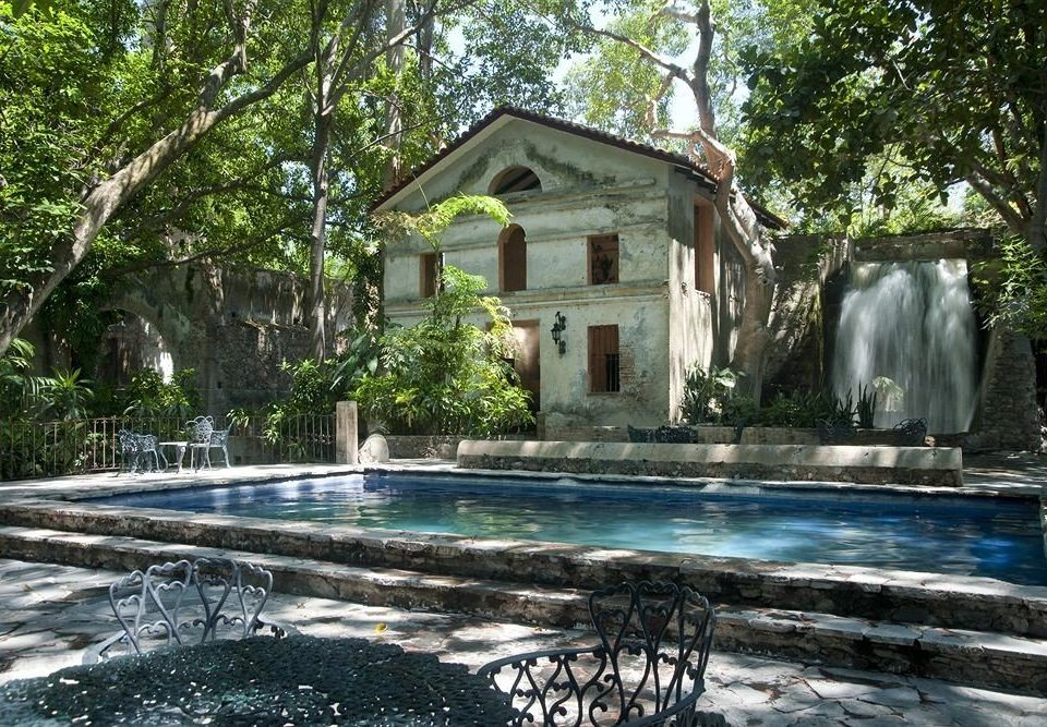 tree property house swimming pool backyard home Nature cottage water feature pond mansion Garden Villa stone