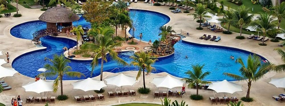 Resort amusement park Water park umbrella leisure park swimming pool outdoor recreation Pool resort town blue recreation plant Party swimming colorful Garden lined surrounded