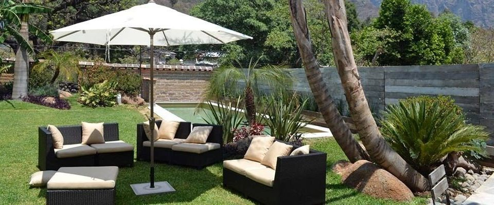 tree grass property chair backyard outdoor structure cottage Villa Garden yard Patio Resort set