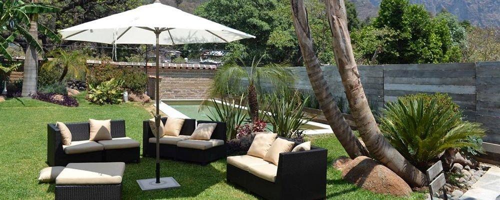tree grass property chair backyard outdoor structure cottage Villa Garden yard Patio Resort set