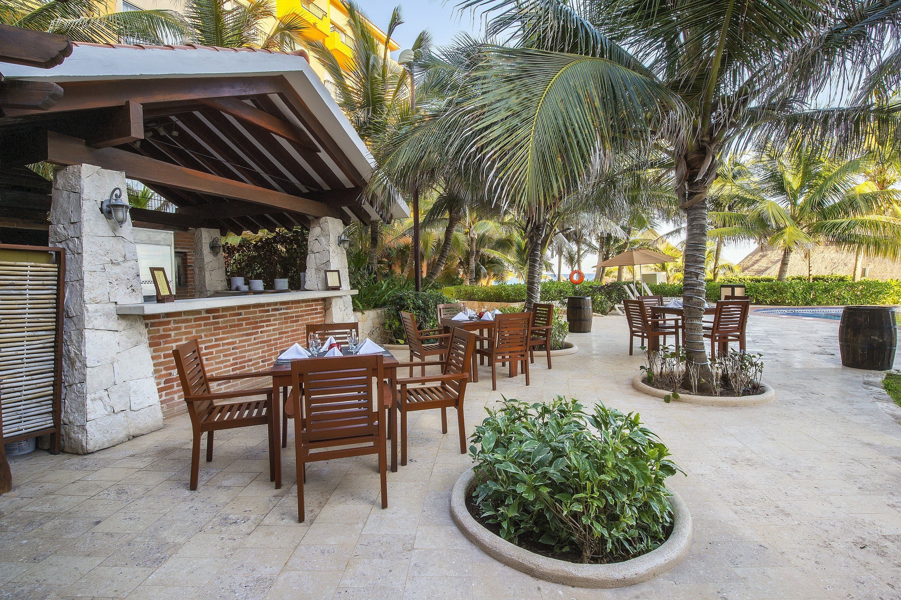 tree ground chair property Resort arecales palm tree outdoor structure Patio wooden backyard Villa plant palm Garden stone