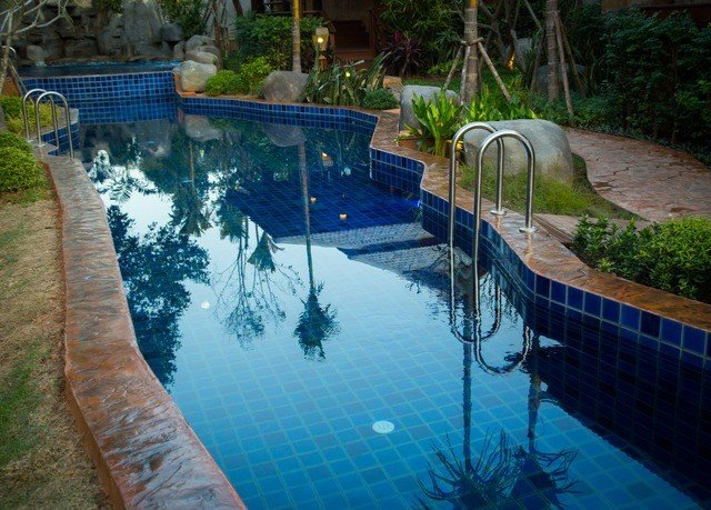 tree swimming pool property backyard pond reflecting pool Pool fish pond Garden
