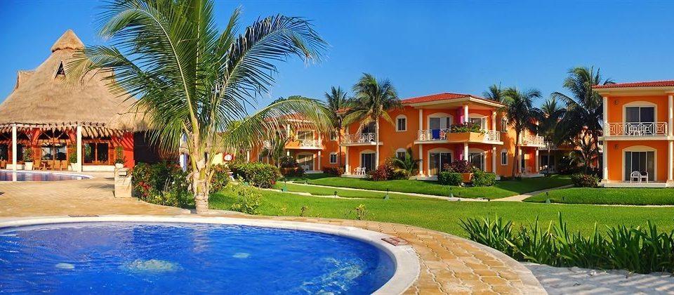 sky tree grass Resort Pool property home house swimming pool Villa hacienda palm mansion Village Garden