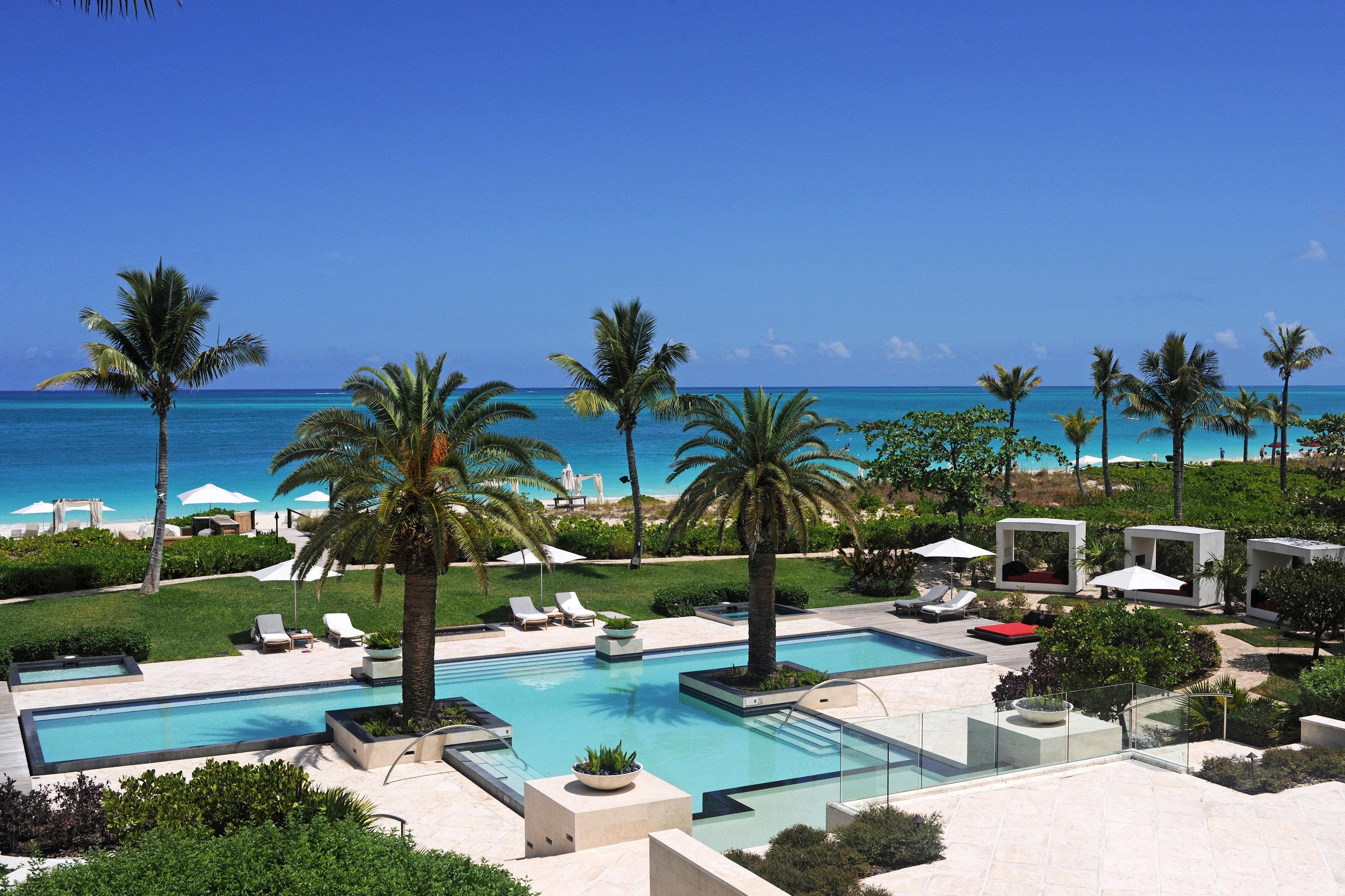 tree sky property Resort palm swimming pool leisure Villa condominium lawn caribbean Pool arecales marina plant shade Garden sandy