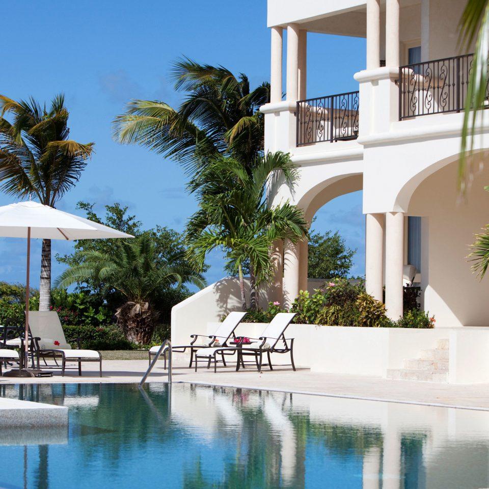 tree Pool building leisure swimming pool property palm Resort condominium Villa arecales plant home swimming marina caribbean Garden shade