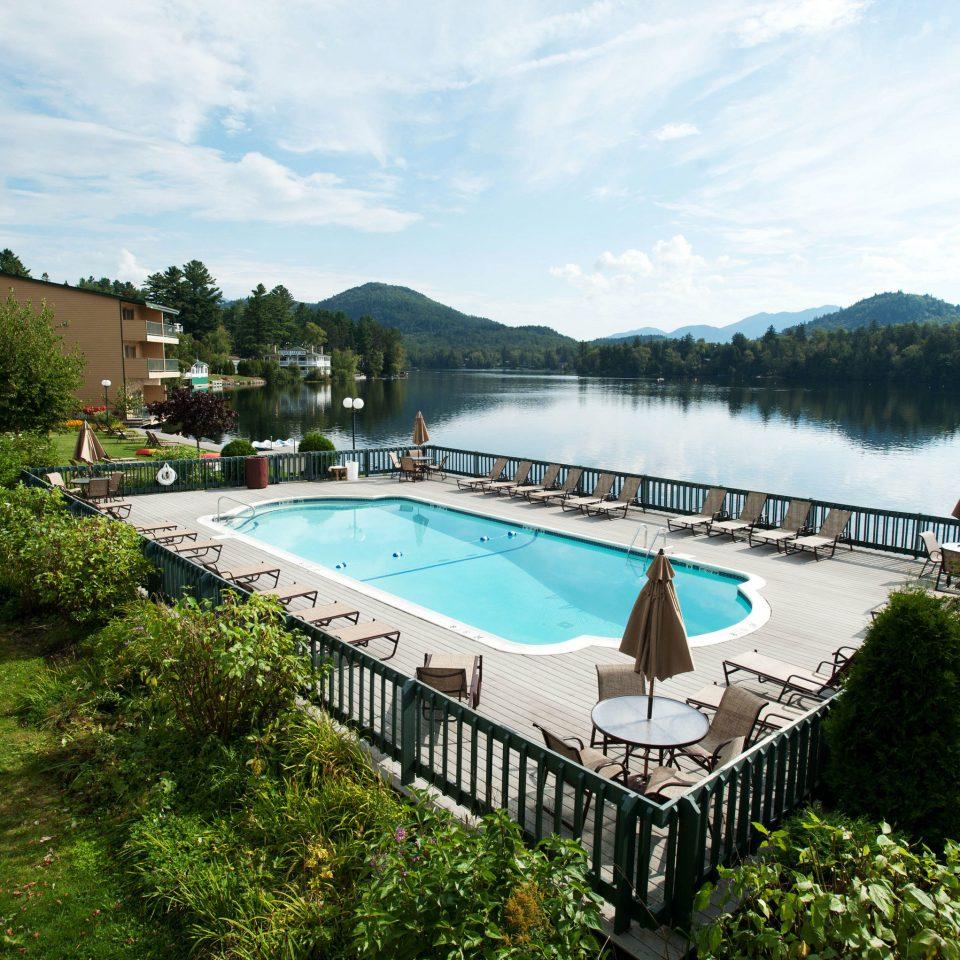 tree grass sky water swimming pool leisure property River Villa Resort mansion Garden