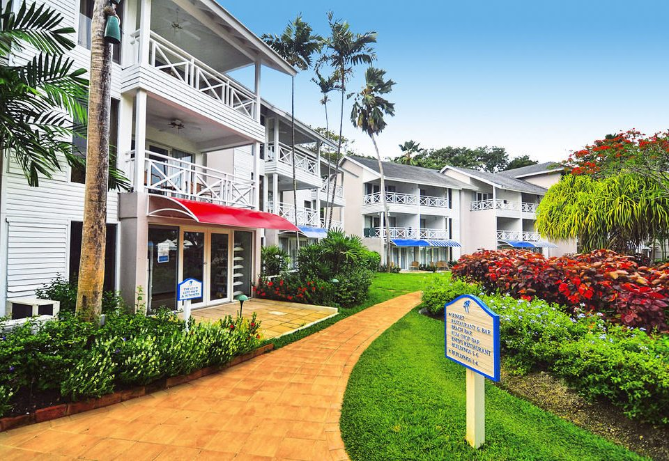 tree grass property residential area neighbourhood Town house home Resort condominium suburb Village flower Garden