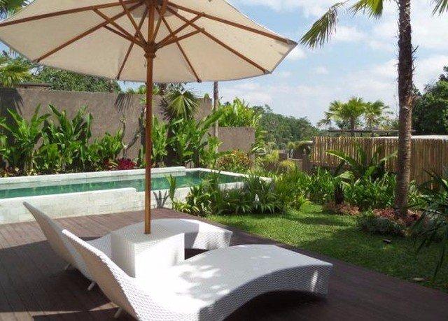 tree umbrella accessory property Villa Resort lawn outdoor structure backyard palm cottage swimming pool shade Garden set