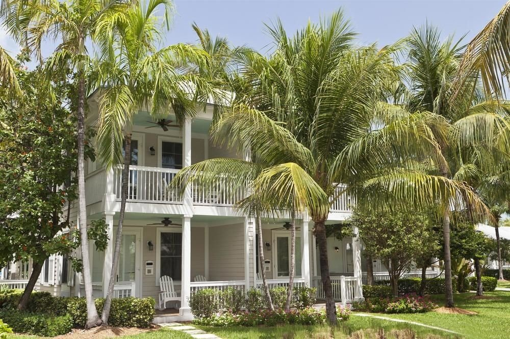 tree sky grass plant property Resort house home arecales palm Villa residential area condominium mansion plantation Garden hacienda cottage