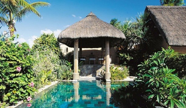 tree building property Resort house Villa cottage Garden hut outdoor structure hacienda swimming pool arecales eco hotel leisure palm tree thatching gazebo roof surrounded stone bushes