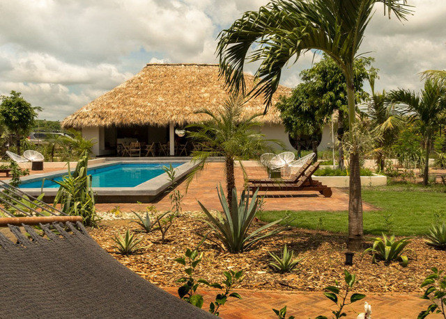 tree ground palm property Resort arecales palm tree Villa landscape leisure swimming pool home plant hacienda landscaping house outdoor structure cottage sandy shade Garden lined