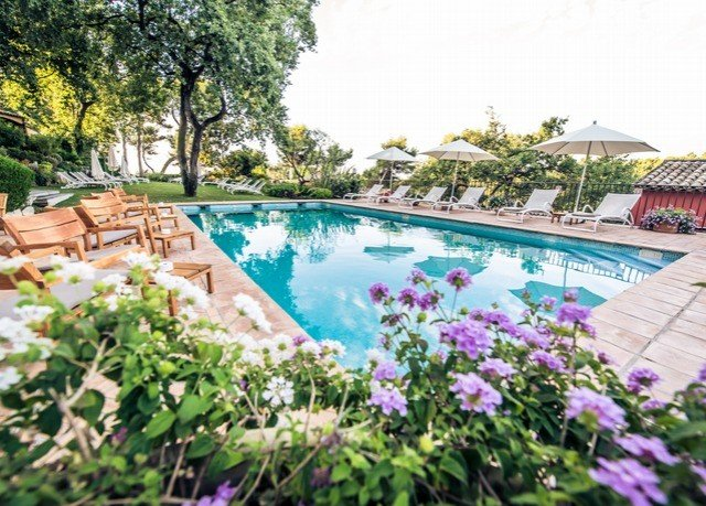 tree swimming pool property flower Resort backyard Villa Garden home landscape architect yard cottage plant colorful surrounded