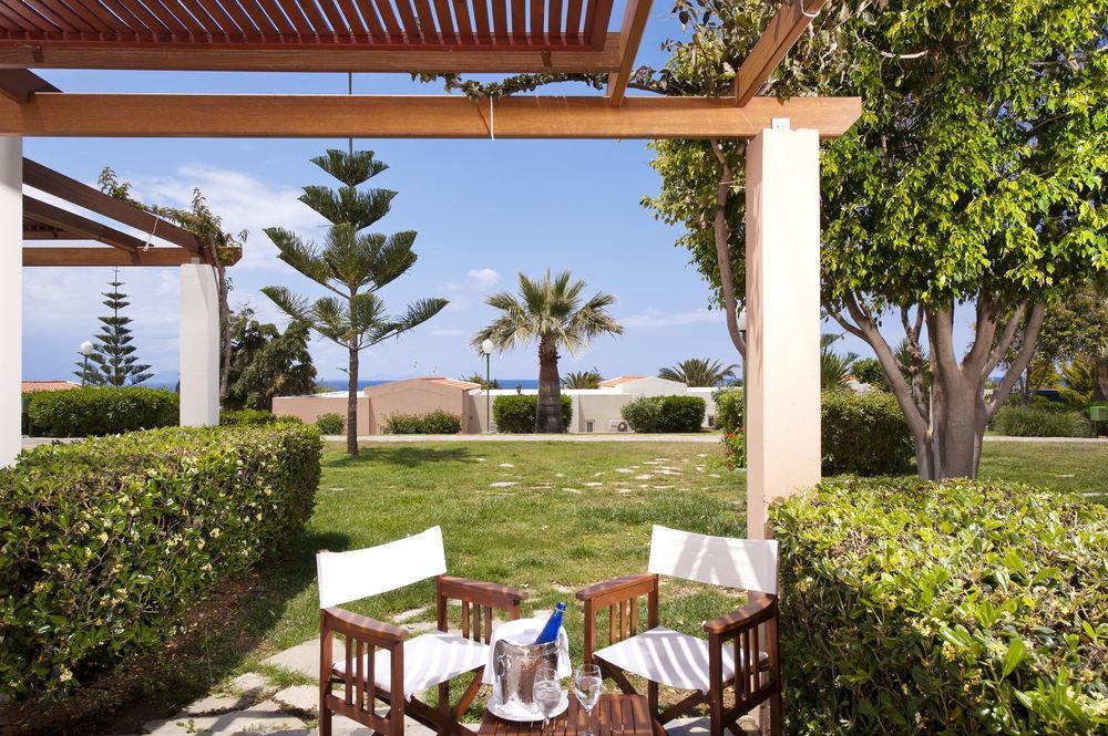 tree grass property chair building Resort Villa home cottage hacienda backyard lawn Garden outdoor structure porch