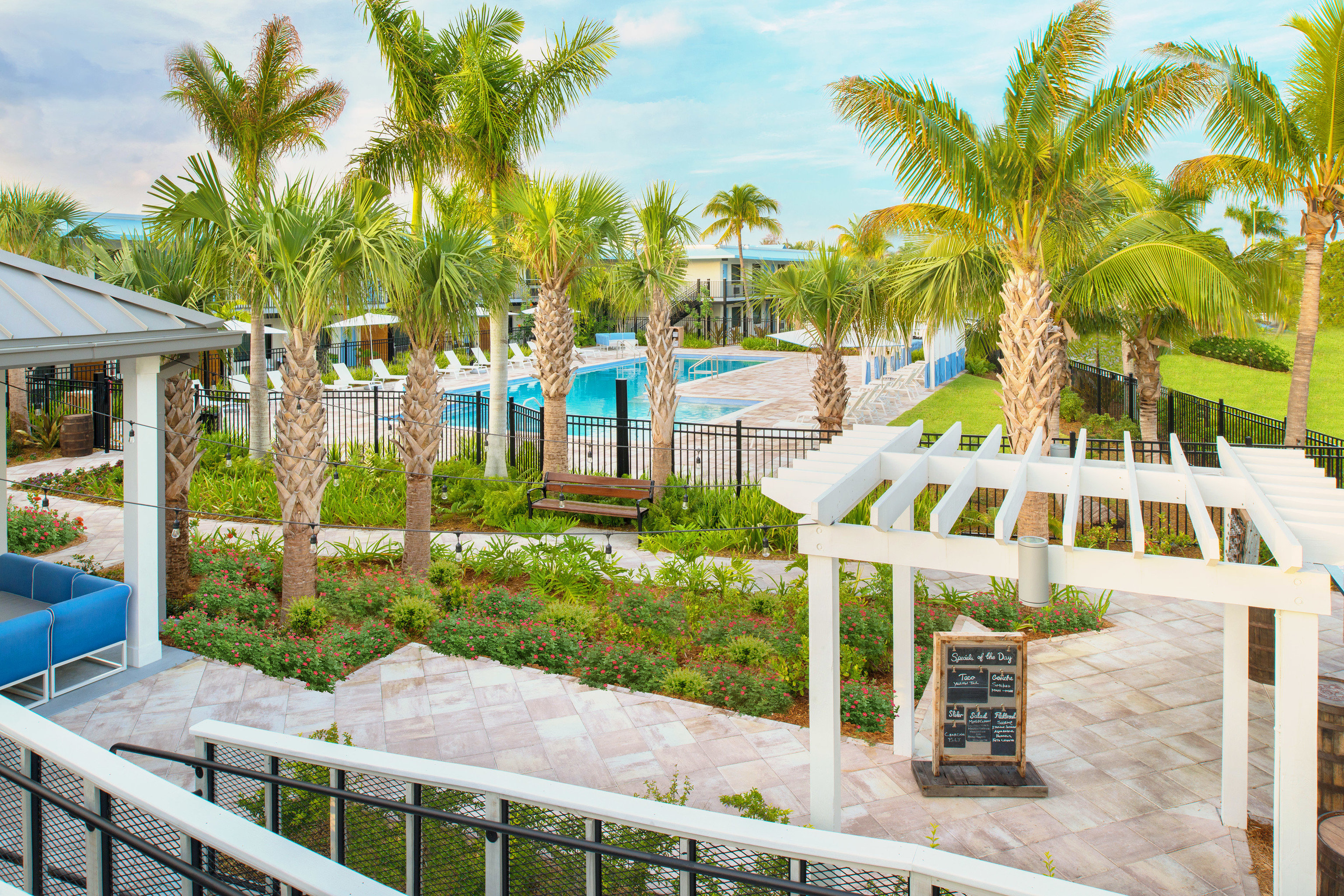 tree sky leisure property Resort palm swimming pool walkway home backyard Villa Garden