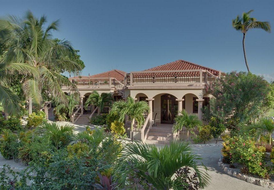 tree sky house property building Resort mansion Villa home palace hacienda Garden plant bushes surrounded