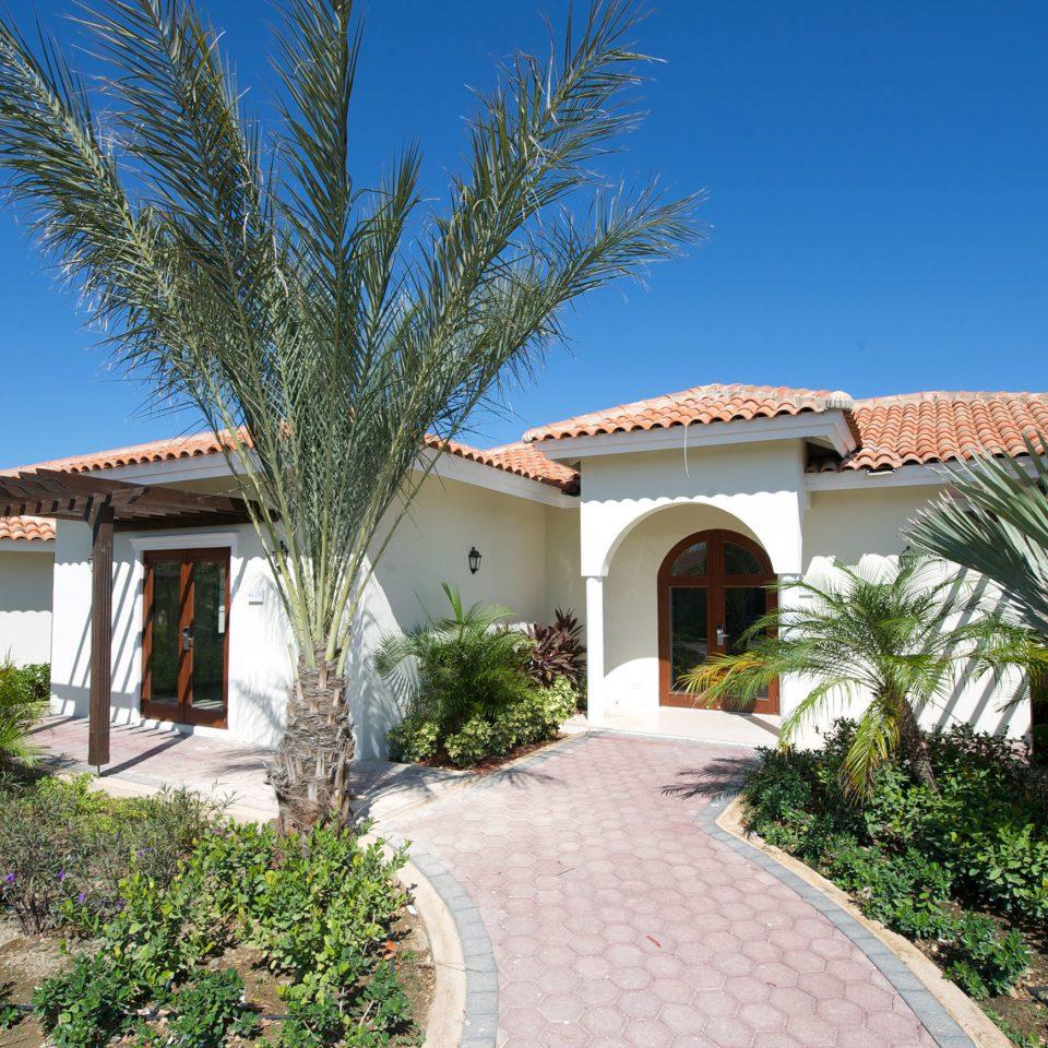 sky tree house building property Villa home Resort residential area Garden hacienda cottage mansion plant stone palm bushes