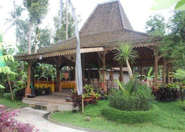 tree grass property building gazebo Resort outdoor structure hacienda eco hotel Villa house Garden cottage porch