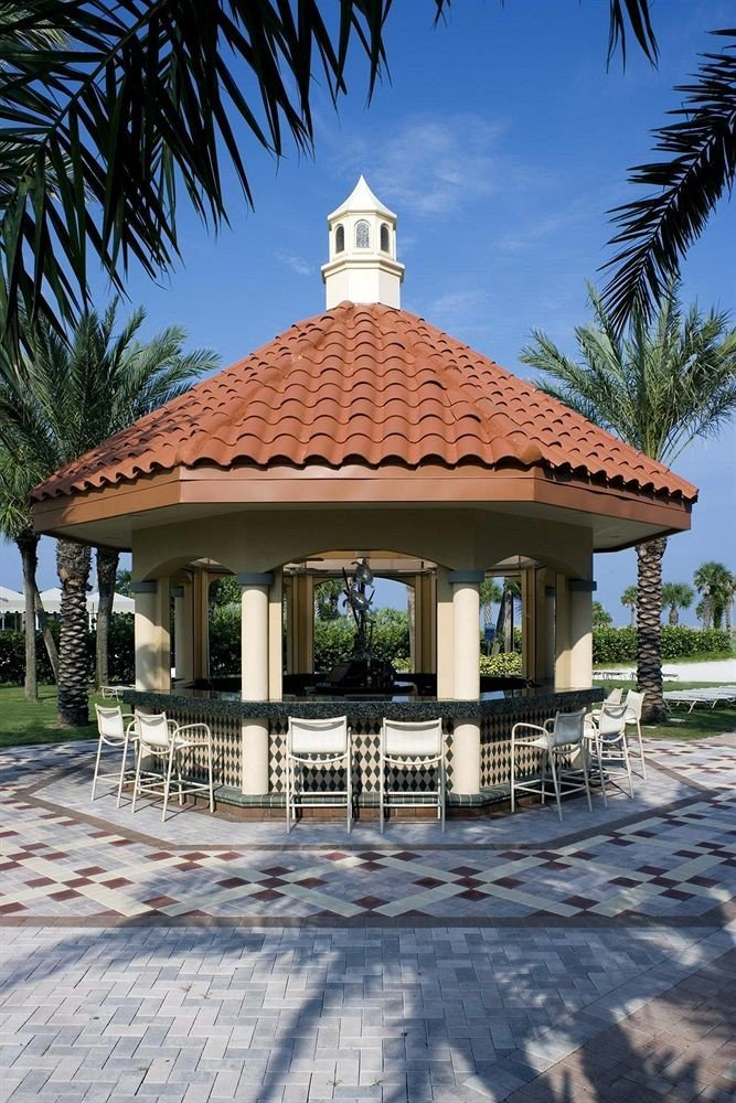tree building sky ground property house gazebo Villa home Resort outdoor structure roof stone Garden