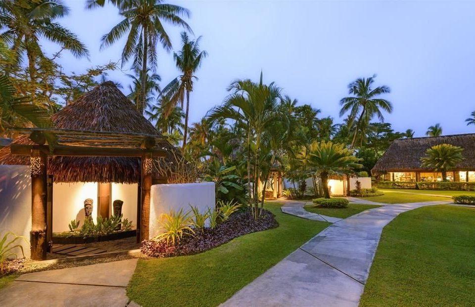 tree grass sky property Resort house palm home Villa hacienda mansion Garden bushes