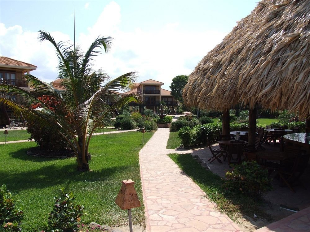sky grass tree property Resort arecales Village Villa Garden flower hacienda walkway plant roof stone