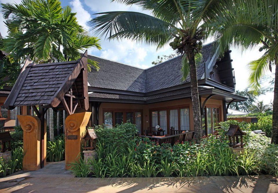 tree ground palm Resort property sidewalk house street home plant arecales Villa cottage eco hotel restaurant Village Garden curb