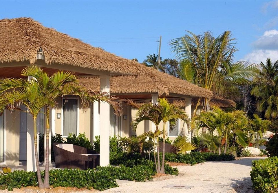 sky building tree house property Resort palm Villa home plant hacienda Village eco hotel cottage Garden bushes stone