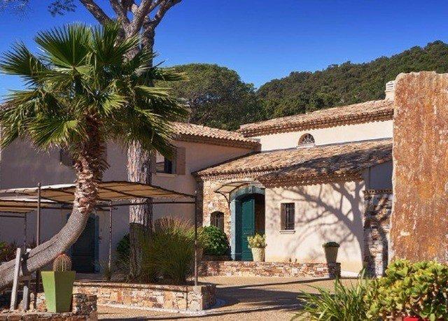 tree property building Villa home Resort plant hacienda cottage mansion Village palm Garden stone