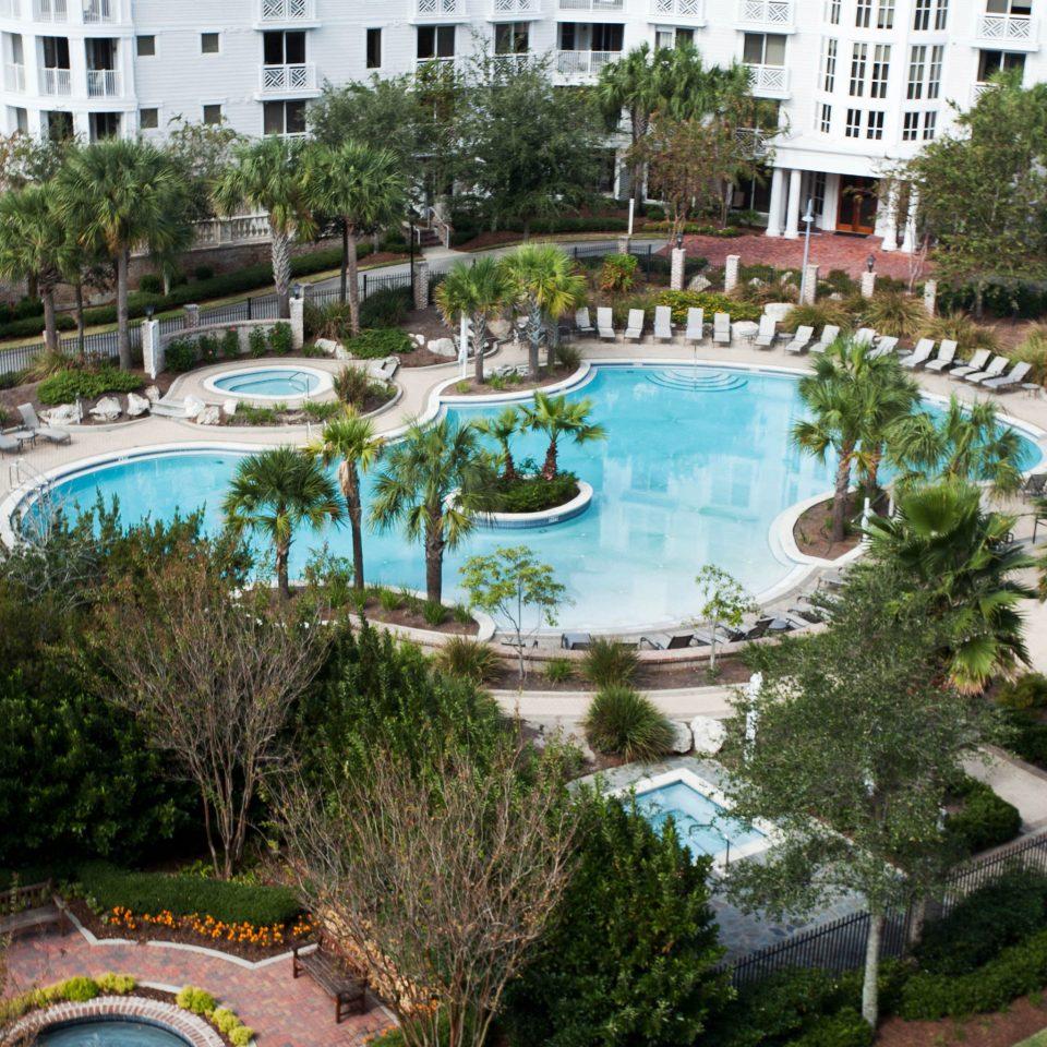 building tree Resort house swimming pool property reflecting pool mansion Garden condominium backyard Water park landscape architect Villa park surrounded