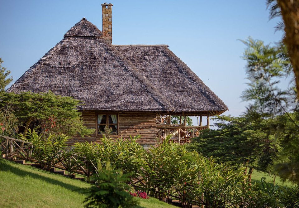 tree sky building grass thatching property house archaeological site cottage hut Village rural area home old farmhouse Resort roof stone Garden surrounded