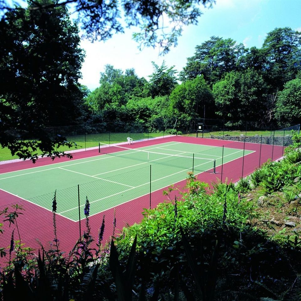 tree grass structure Sport athletic game tennis sport venue red baseball field tennis court baseball park stadium soccer specific stadium lawn Garden lush