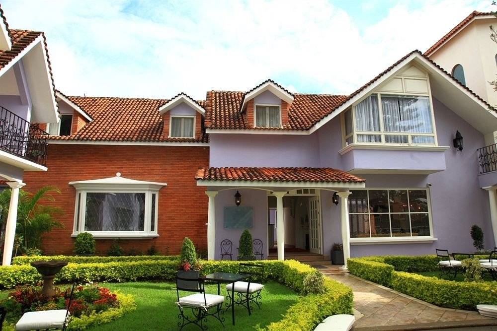 grass building house home property residential area lawn suburb siding Villa old mansion cottage neighbourhood farmhouse roof Garden residential stone older