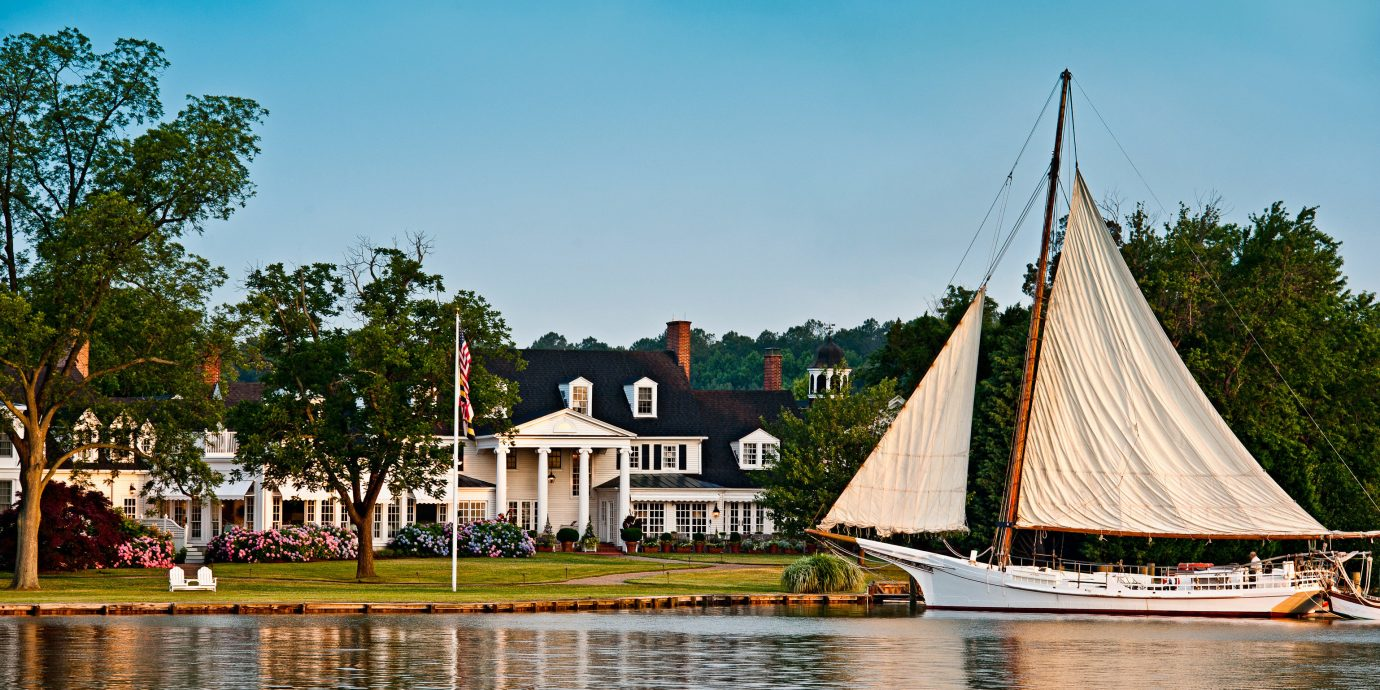 Boat Classic Elegant Exterior Family Grounds Historic Hotels Inn River Trip Ideas Waterfront outdoor water sky tree watercraft vehicle transport vacation tourism boating reflection Lake waterway sailing vessel docked