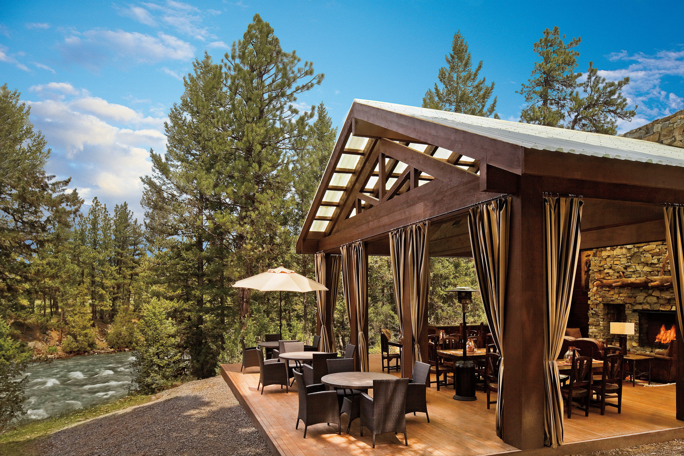 Glamping Hotels Montana Outdoors + Adventure Trip Ideas tree sky property building home log cabin cottage outdoor structure Resort