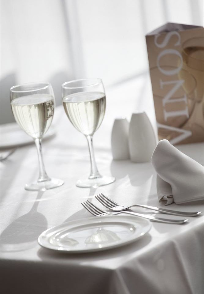 white wine glass wine glass restaurant stemware tablecloth