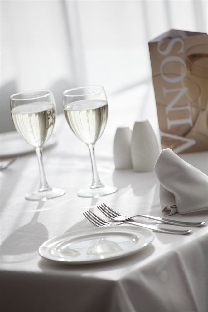 white wine glass wine glass restaurant stemware tablecloth