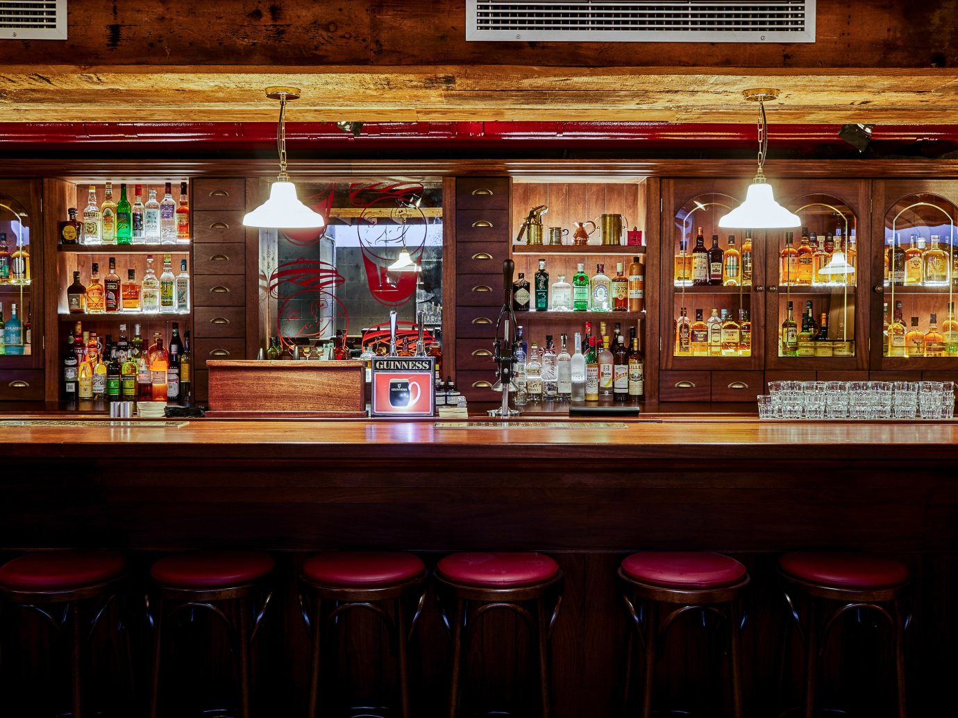 Food + Drink London shelf indoor Bar pub liquor store tavern store restaurant interior design several